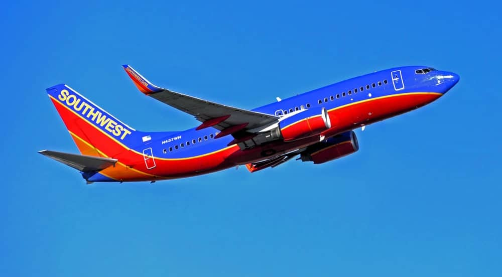 Southwest Airlines flying in the blue sky.