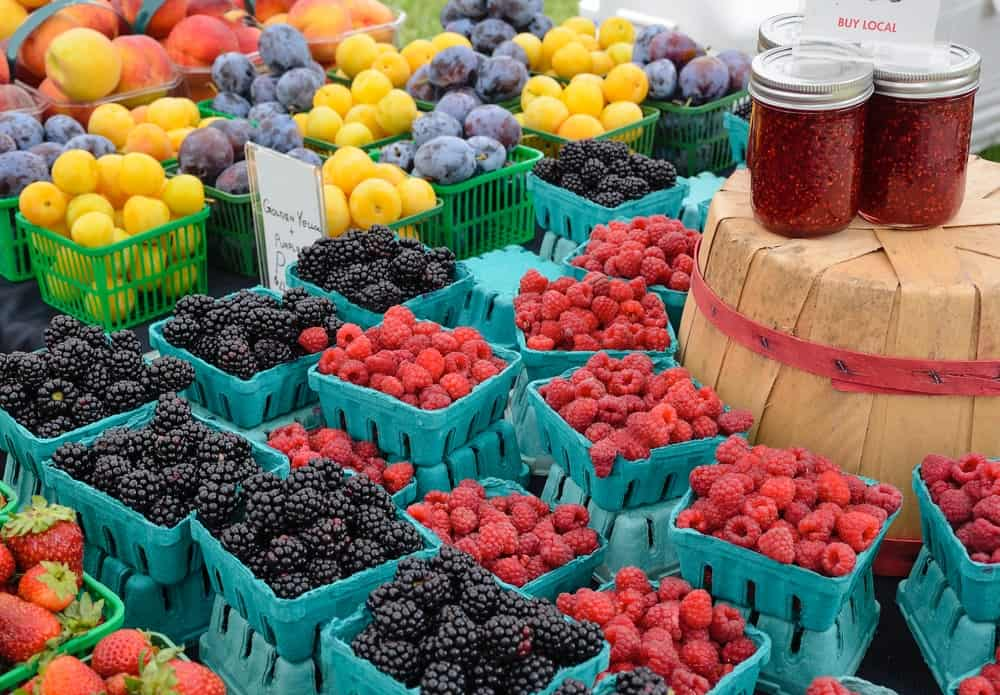 Assorted berries on an outdoor farmers market.
