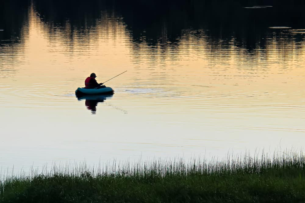 Lone man fishing on Lone Lake.