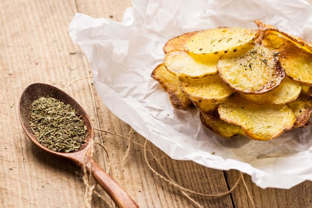 Homemade potato chips with spices.