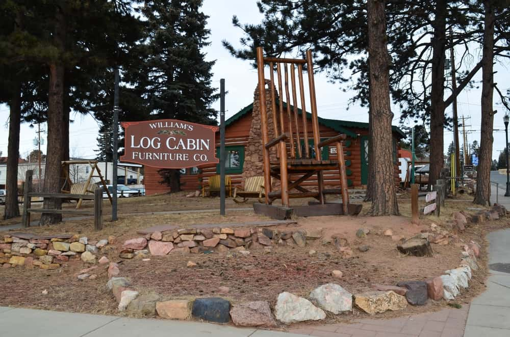 One of the most recognizable landmarks in the town is the giant wooden rocking chair set outside of the William's Log Cabin Furniture Co.