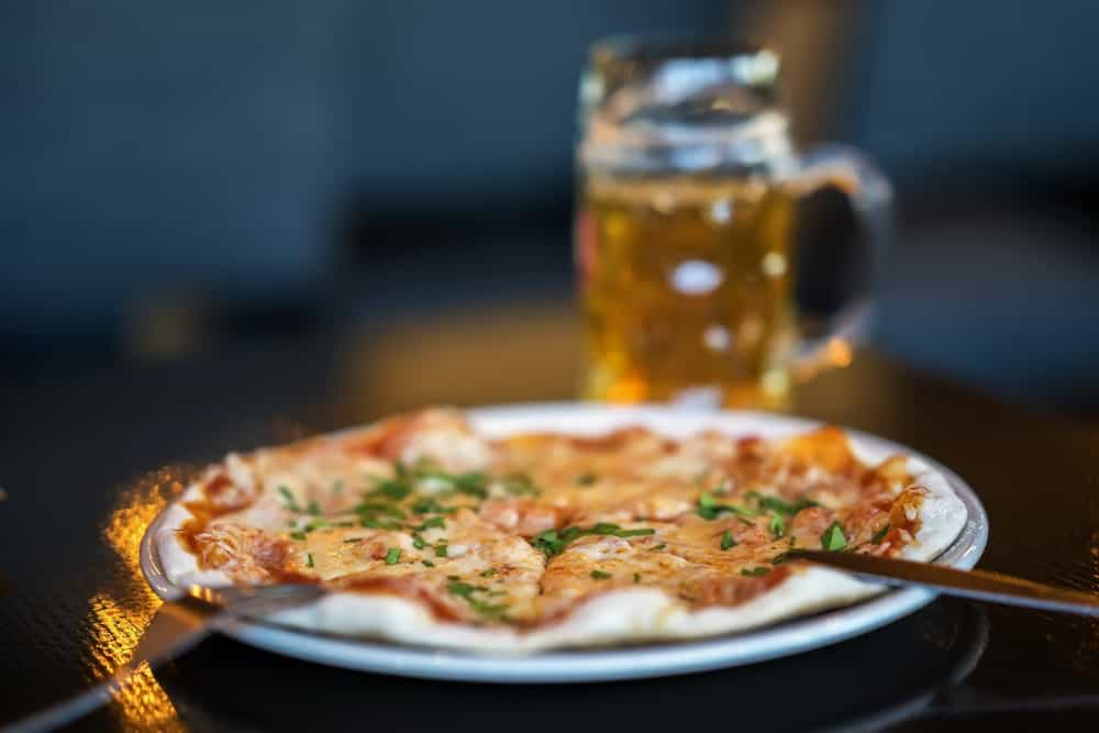 A focused look at an appetizing pizza on a plate, which you can order in St. Augustine's Mellow Mushroom.