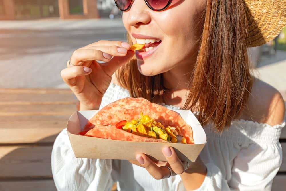 This woman is happily eating her tacos, which you can also enjoy at the Taco Gringos in St. Augustine.
