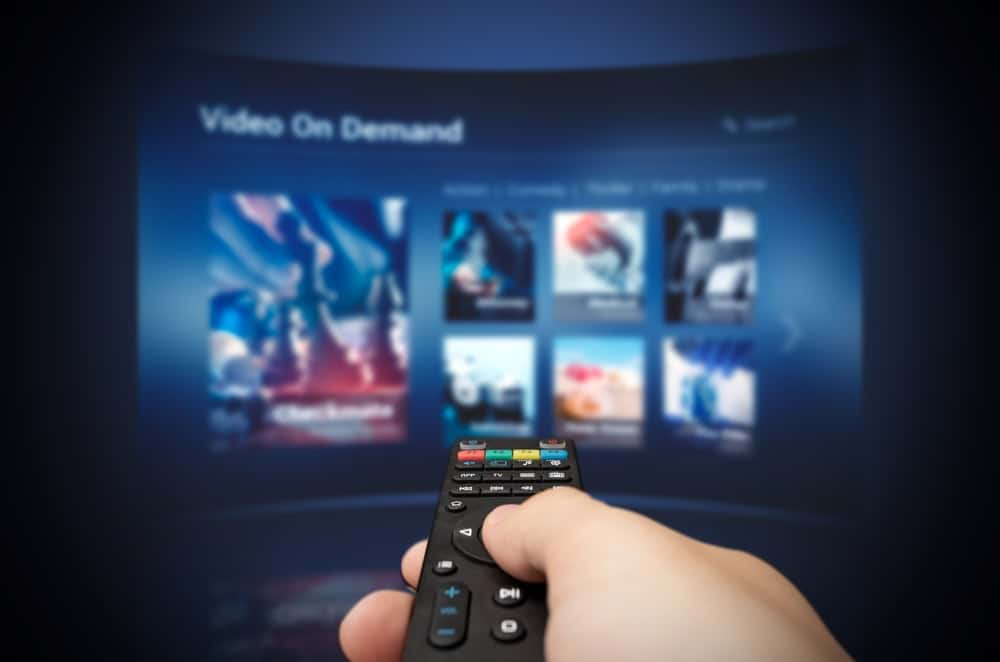 A person choosing from the Video On Demand Screen Selection.