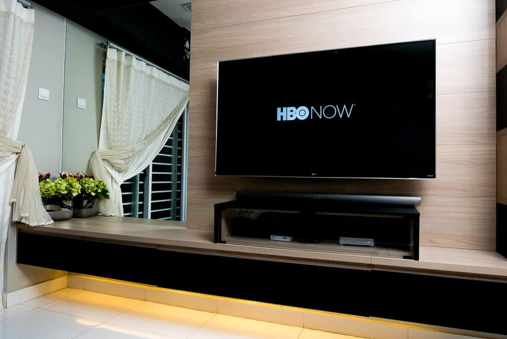 Wall-mounted TV displaying HBO NOW app.