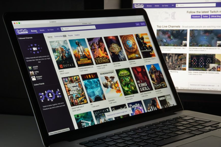 A laptop screen showing the homepage of Twitch Stream website.