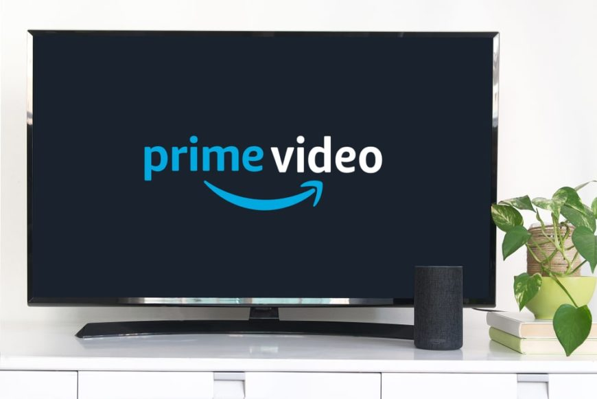 A living room TV showing the Amazon Prime logo.