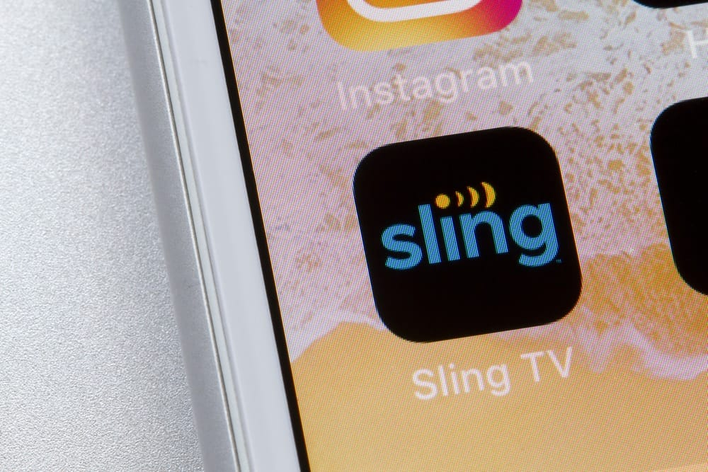 This is a close look at the Sling App logo on the mobile phone home screen.