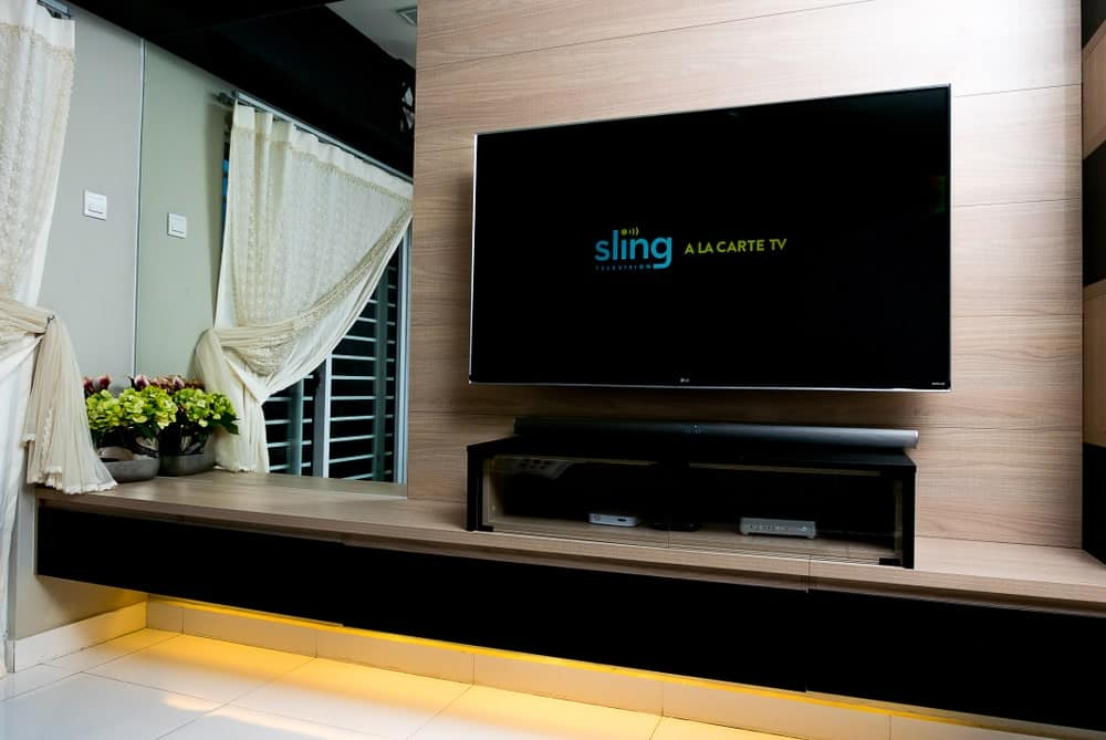 Wall-mounted TV displaying Sling TV app.