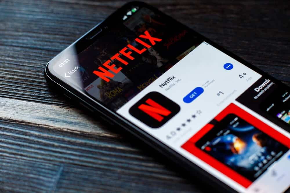 A mobile phone showing the download page for Netflix at the App Store.
