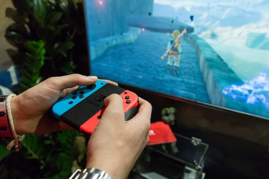 A close look at a gamer playing Legend of Zelda on Nintendo Switch.