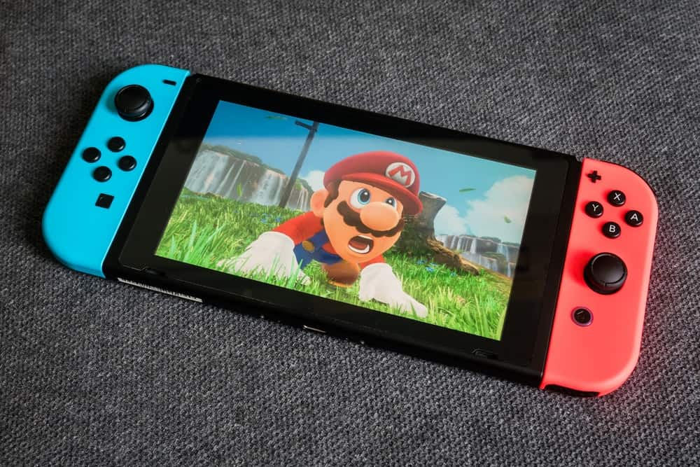 A close look at a Nintendo Switch on a carpet.