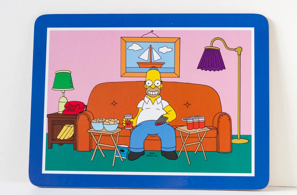This is a coaster with a picture of The Simpsons' Homer Simpson on the sofa.