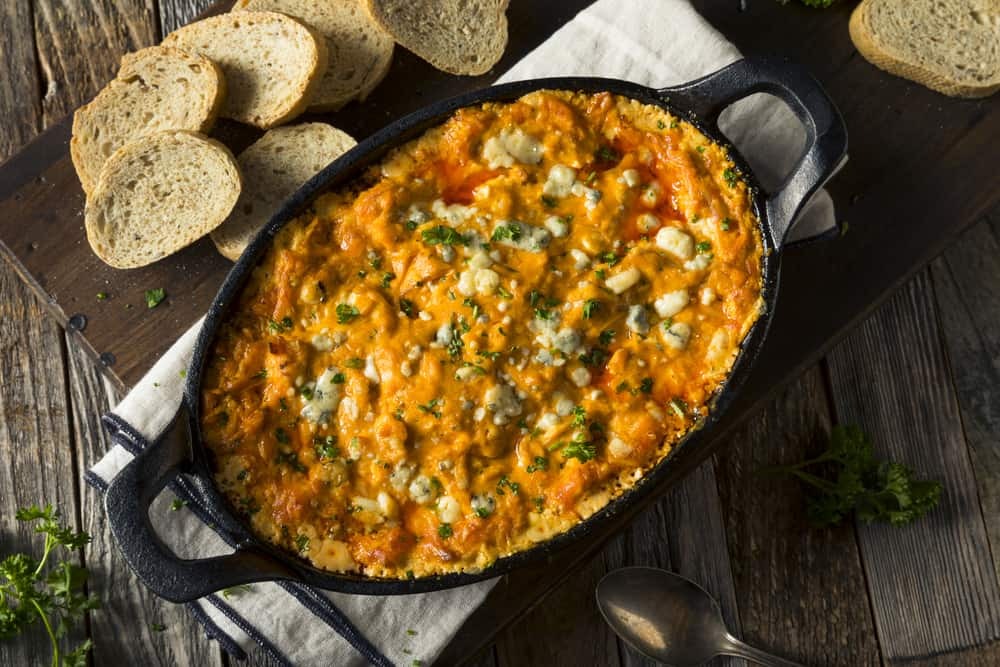 Buffalo chicken dip with cheese and crostini