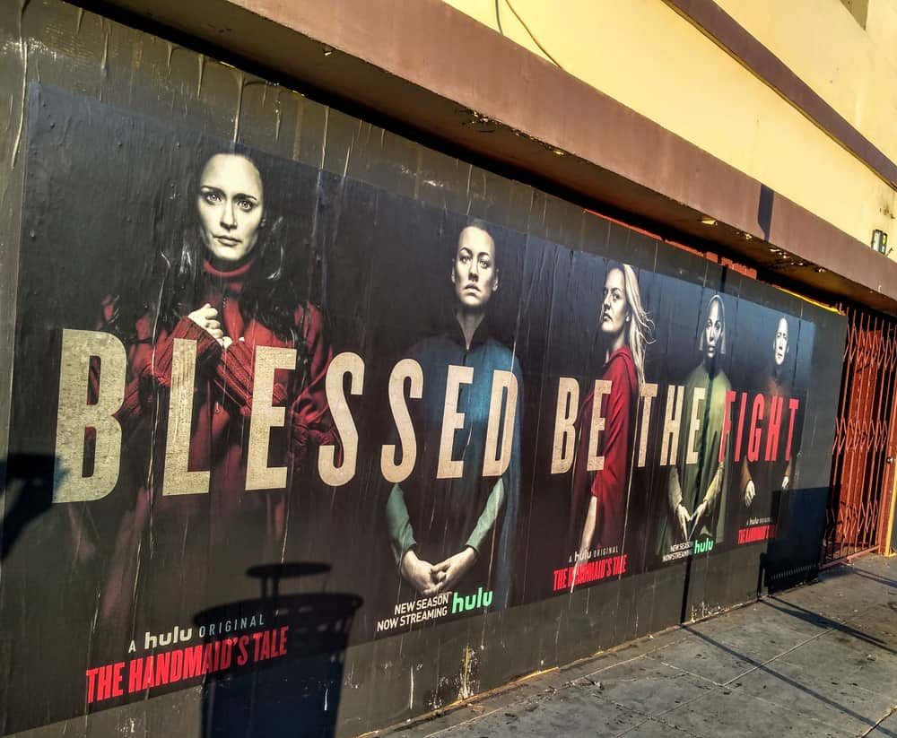 A close look at a street poster for the Handmaid's Tale TV Show.