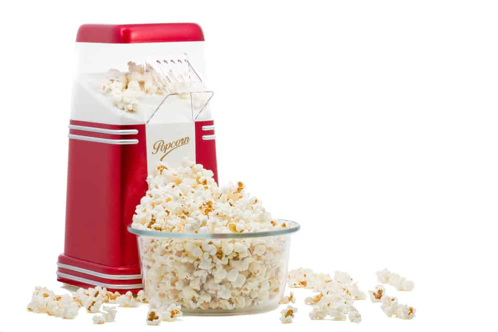 This is a Hot Air Popcorn Maker with an overflowing bowl of popcorn.