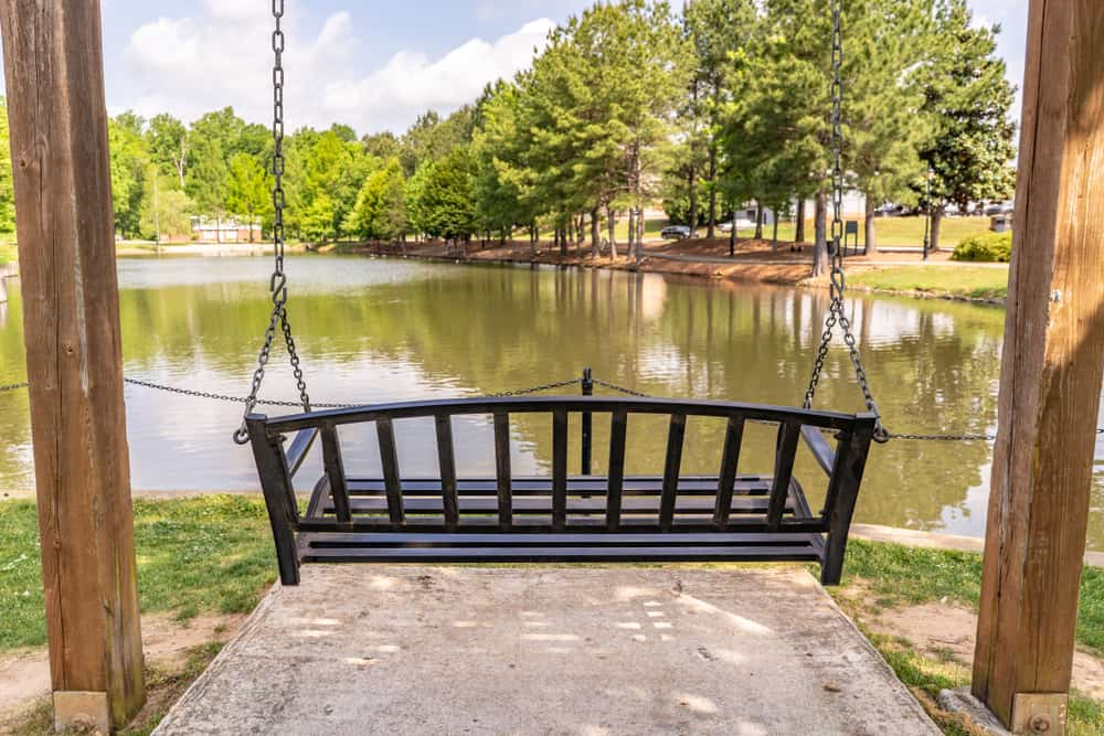This is a hanging bench facing the pond in a park in South Carolina.
