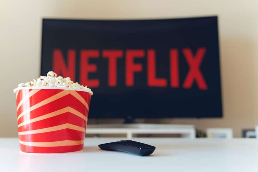 TV displaying Netflix logo with popcorn on the side.