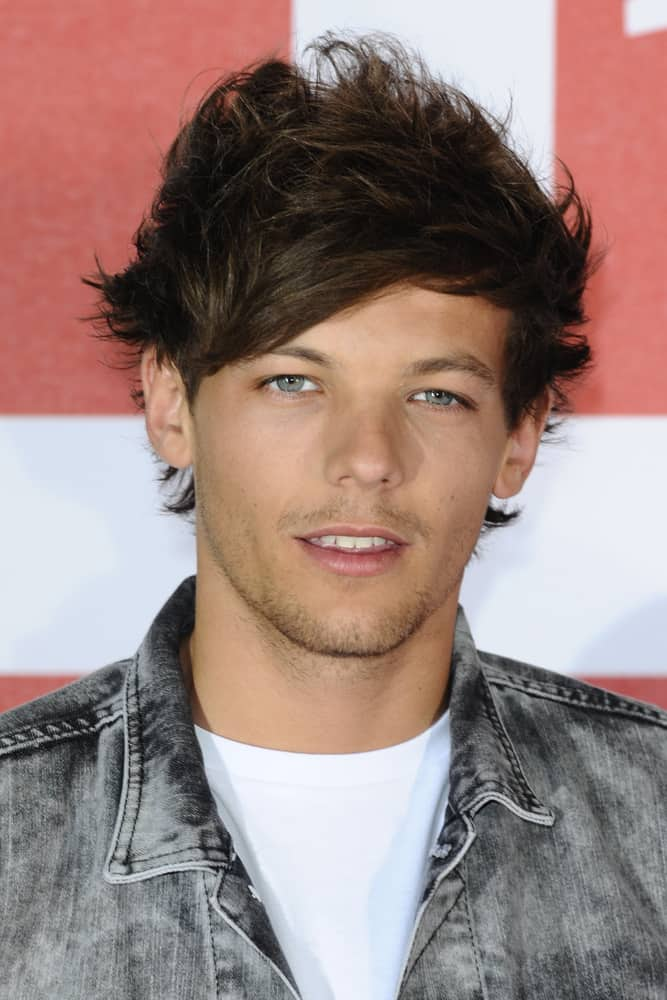 Louis Tomlinson attended the 2013 movie premiere of This is Us.