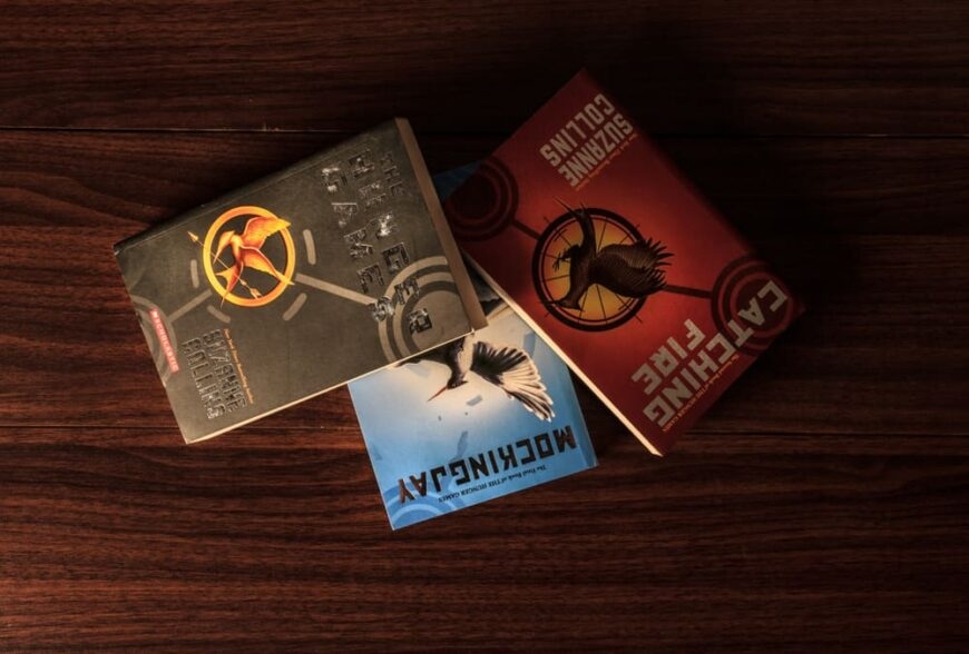 The book s of the Hunger Games Trilogy on a table.